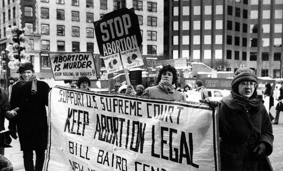 Boston, MA - 1/22/1984: People in support of and against the legality of abortion rally outside Faneuil Hall in Boston, Jan. 22, 1984. (John Blanding/Globe Staff) --- BGPA Reference: 170224_EF_011